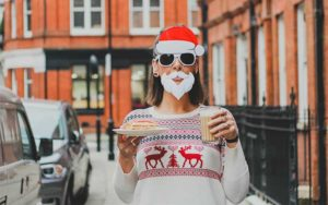 girl wearing holiday glasses